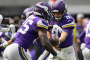 Kirk Cousins #8 of the Minnesota Vikings hands the ball off to teammate Latavius Murray #25 during the second quarter in the preseason game on August 18, 2018 at US Bank Stadium in Minneapolis, Minnesota.