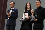 Chief Marketing Officer of Jaeger-LeCoultre Nicolas Siriez introduces Chinese Director Zhang Yimou to receive The Jaeger-LeCoultre Glory To The Filmmaker Award and Reverso engraved watch from during the 75th Venice International Film Festival  at Sala Grande on September 6, 2018 in Venice, Italy.