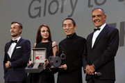 Venice Film Festival Director Alberto Barbera introduces Chinese Director Zhang Yimou to receive The Jaeger-LeCoultre Glory To The Filmmaker Award and Reverso engraved watch from Chief Marketing Officer of Jaeger-LeCoultre Nicolas Siriez during the 75th Venice International Film Festival  at Sala Grande on September 6, 2018 in Venice, Italy.