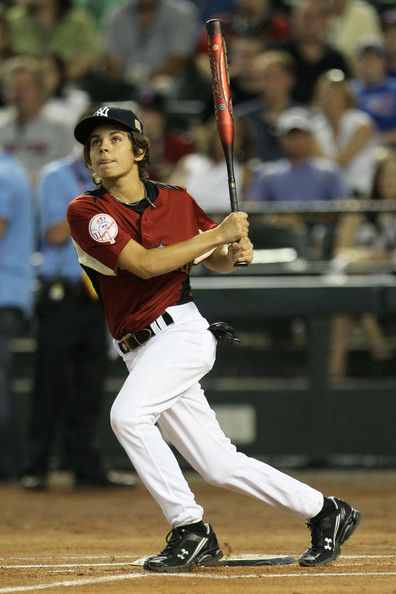 Jake T. Austin Actor Jake T. Austin takes a swing during the 2011 Taco Bell All-Star Legends & Celebrity Softball Game at Chase Field on July 10, 2011 in Phoenix, Arizona.