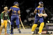 Shoaib Malik (L) and Raymon Reifer (R) of Barbados Tridents 100 partners during the Second Semi Final of the Caribbean Premier League between Barbados Tridents v Jamaica Tallawahs at Queens Park Oval on August 23, 2013 in Port of Spain, Trinidad and Tobago.