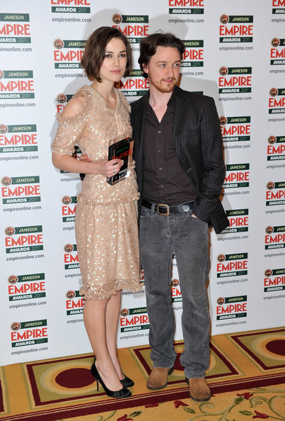 Actress Keira Knightley with the Empire Hero Award presented by Jameson Irish Whiskey with award presenter James McAvoy during the Jameson Empire Awards held at Grosvenor House Hotel, London, England on 27 March 2011.