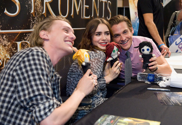 Jamie Campbell Bower Kevin Zeger (L) Jamie Campbell Bower (C) and Lily Collins at the Mall of America for a meet and greet for fans in anticipation for Screen Gems's action-fantasy THE MORTAL INSTRUMENTS: CITY OF BONES, on July 28, 2013 in Bloomington, Minnesota.