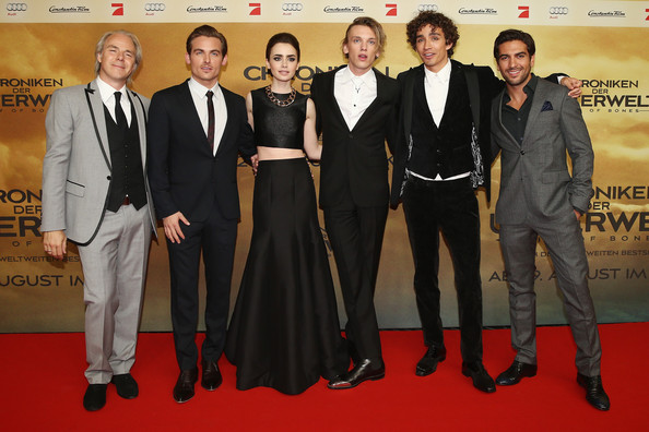 Jamie Campbell Bower (L-R) Director Harald Zwart, Kevin Zegers, Lily Collins, Jamie Campbell Bower, Robert Sheehan and Elyas M'Barek arrive for the 'The Mortal Instruments: City of Bones' (Chroniken der Unterwelt) Germany premiere at Sony Centre on August 20, 2013 in Berlin, Germany.