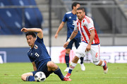 Shinji Okazaki of Japan controls the ball under prssure of Richard Ortiz of Paraguay during the international friendly match between Japan and Paraguay at Tivoli Stadion on June 12, 2018 in Innsbruck, Austria.