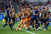 Takashi Inui of Japan celebrates with teammates after scoring his team's first goal during the 2018 FIFA World Cup Russia group H match between Japan and Senegal at Ekaterinburg Arena on June 24, 2018 in Yekaterinburg, Russia.