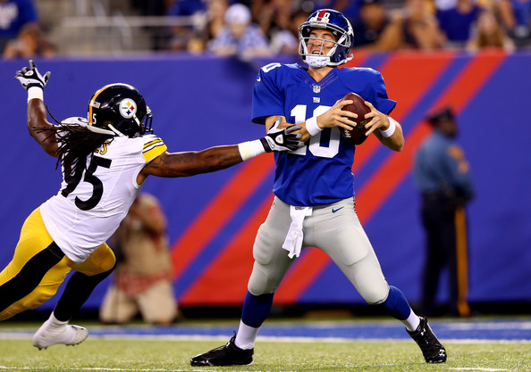 Jarvis Jones Quarterback Eli Manning #10 of the New York Giants is sacked by outside linebacker Jarvis Jones #95 of the Pittsburgh Steelers during a preseason game at MetLife Stadium on August 9, 2014 in East Rutherford, New Jersey.