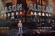 """(L-R) Pedal steel guitarist Jay Jackson, recording artist Jason Aldean, drummer Rich Redmond, bassist Tully Kennedy and guitarist Jack Sizemore perform during the launch of Aldean's three-night """"JASON ALDEAN: RIDE ALL NIGHT VEGAS"""" engagement at Park Theater at Park MGM on December 6, 2019 in Las Vegas, Nevada."""