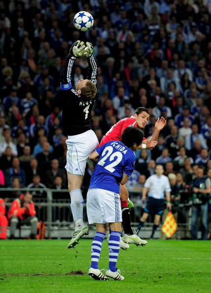 Javier Hernandez Manuel Neuer of Schalke claims the ball under pressure from Javier Hernandez of Manchester United during the UEFA Champions League Semi Final first leg match between FC Schalke 04 and Manchester United at Veltins Arena on April 26, 2011 in Gelsenkirchen, Germany.