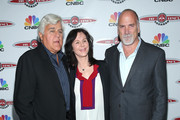 """(L-R) Jay Leno, Mavis Leno and Senior Vice President of Primetime Alternative at CNBC Jim Ackerman attend """"Jay Leno's Garage"""" Launch Party at Press Lounge at Ink48 on October 7, 2015 in New York City."""