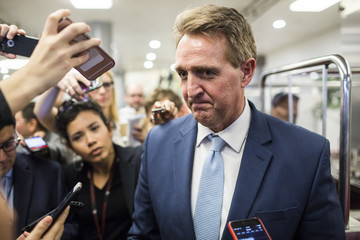 Jeff Flake Senate Lawmakers Vote on FISA After House Passes Renewal, While Continuing to Negotiate Dream Act