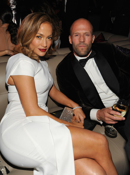 The 2016 InStyle and Warner Bros. 73rd Annual Golden Globe Awards Post-Party [leg,thigh,formal wear,suit,event,nightclub,dress,tuxedo,human leg,sitting,jason statham,jennifer lopez,actress,the beverly hilton hotel,beverly hills,instyle,warner bros.,post-party,warner bros. 73rd annual golden globe awards,golden globe awards post-party]