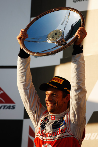 Jenson Button Jenson Button of Great Britain and McLaren celebrates on the podium after winning the Australian Formula One Grand Prix at the Albert Park circuit on March 18, 2012 in Melbourne, Australia.