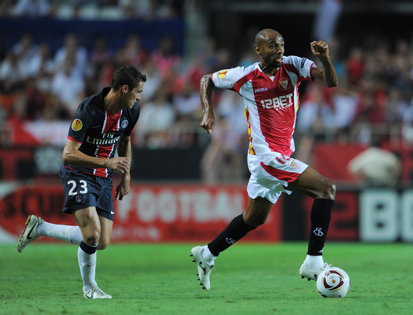 Jeremy Clement Frederic Kanoute (R) of Sevilla runs for the ball with Jeremy Clement of Paris Saint Germain during the UEFA Europa League group J match between Sevilla and Paris Saint Germain at the Estadio Ramon Sanchez Pizjuan on September 16, 2010 in Seville, Spain.