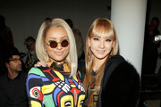 Actress/singer Kat Graham and singer CL 2ne1 attend the Jeremy Scott fall 2013 fashion show during MADE fashion week at Milk Studios on February 13, 2013 in New York City.