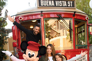 In this handout photo provided by Disney Parks, Actress Jessica Alba, husband Cash Warren and daughters Honor and Haven take a ride with Mickey Mouse on the Red Car Trolley at Disney California Adventure Park on March 31, 2017 in Anaheim, California.