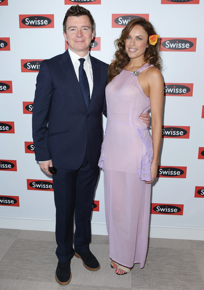 Celebrities Attend Emirates Stakes Day [suit,clothing,carpet,formal wear,premiere,pantsuit,event,red carpet,flooring,tuxedo,celebrities,marquee,richard ``rick astley,jess mcnamee,australia,melbourne,flemington racecourse,swisse,emirates stakes day]