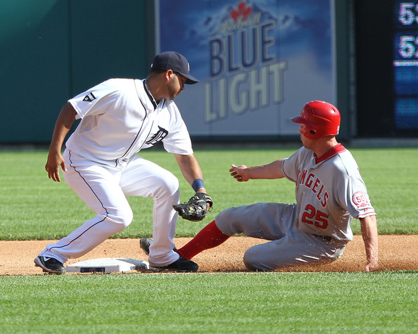 Jhonny Peralta Shortstop, Jhonny Peralta #27 of the Detroit Tigers is late on the tag as Peter Bourjos  #25 of the Los Angeles Angels of Anaheim steals second base during a MLB game at Comerica Park on July 30, 2011 in Detroit, Michigan.