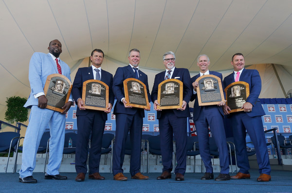 National Baseball Hall Of Fame Induction Ceremony [photograph,team,uniform,competition event,crew,event,championship,award,inductees,vladimir guerrero,jim thome,alan trammell,trevor hoffman,plaques,l-r,national baseball hall of fame induction ceremony,induction ceremony]