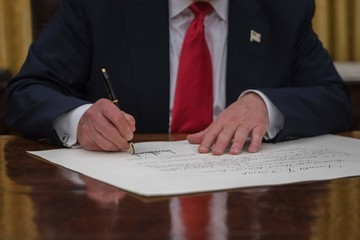 Jim Watson US President Donald Trump Signs First Executive Orders at the White House