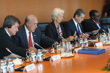Jim Yong Kim Merkel Meets With Finance, Development And Labor Institution Heads