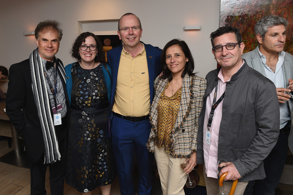 IMDb's 2018 Cannes Dinner Party - The 71st Annual Cannes Film Festival [social group,event,community,team,tourism,art,karen,col needhamm,ceo,lawrence foldes,joana vicente,table,cannes,imdb,dinner party,cannes film festival]