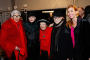 (L-R) Iris Apfel, Designer Joanna Mastroianni, Ruth Finley, Mary Louluther and Debbie Dickinson pose backstage at the Joanna Mastroianni Fall 2013 fashion show during Mercedes-Benz Fashion Week at The Studio at Lincoln Center on February 10, 2013 in New York City.