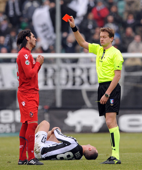 AC Siena v Cagliari Calcio - Serie A [player,sports,sports equipment,team sport,ball game,soccer player,football player,soccer,football,sport venue,serie a,ac siena,cagliari calcio,siena,cagliari,italy,artemio franchi,referee,dino tommasi,joaquin larrivey]