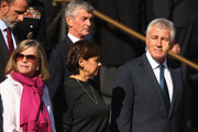U.S. Defense Secretary Chuck Hagel (R), his wife Lilibet Ziller (2nd L), Secretary of the Army John McHugh and others attend a wreath laying ceremony at the Tomb of the Unknowns during Veterans Day observations at Arlington National Cemetery November 11, 2014 in Arlington, Virginia. Originally established as Armistice Day in 1919, the holiday was renamed Veterans Day in 1954 by President Dwight Eisenhower.