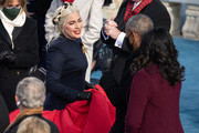 Former US First Lady Michelle Obama and former US President Barack Obama greet Lady Gaga (R) during the 59th Presidential Inauguration at the U.S. Capitol on January 20, 2021 in Washington, DC. During today's inauguration ceremony Joe Biden becomes the 46th president of the United States.