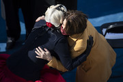 Lady Gaga and Senator Amy Klobuchar (D-MN) hug at the end of the inauguration ceremony for Joe Biden on the West Front of the U.S. Capitol in on January 20, 2021 in Washington, DC. After today's inauguration ceremony Joe Biden becomes the 46th president of the United States.