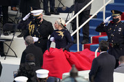 Lady Gaga, escorted by Marine Capt. Evan Campbell, arrives to sing the national anthem at the West Front of the U.S. Capitol during the inauguration of U.S. President-elect Joe Biden on the West Front of the U.S. Capitol on January 20, 2021 in Washington, DC.  During today's inauguration ceremony Joe Biden becomes the 46th president of the United States.