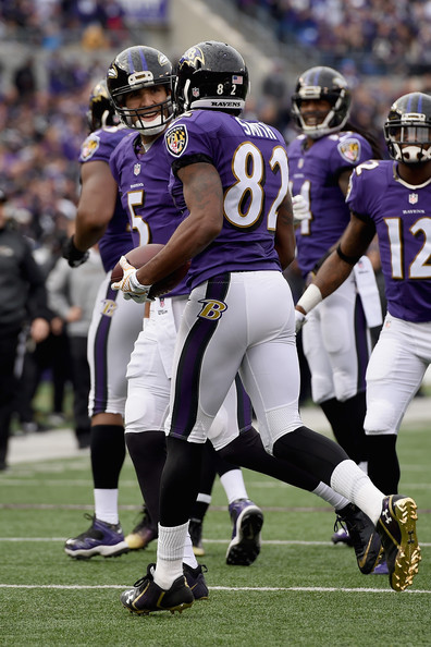 San Diego Chargers v Baltimore Ravens [gridiron football,sports,sports gear,american football,helmet,canadian football,team sport,sprint football,ball game,player,torrey smith,joe flacco,m t bank stadium,baltimore,maryland,baltimore ravens,san diego chargers,touchdown]