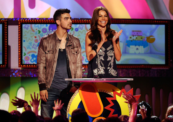 Joe Jonas Singer Joe Jonas (L) and actress Sofia Vergara speak onstage during Nickelodeon's 24th Annual Kids' Choice Awards at Galen Center on April 2, 2011 in Los Angeles, California.