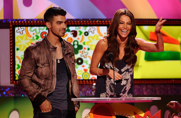 Joe Jonas Singer Joe Jonas and actress Sofia Vergara stand and address the audience onstage during Nickelodeon's 24th Annual Kids' Choice Awards at Galen Center on April 2, 2011 in Los Angeles, California.