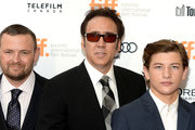"""(L-R)   Producer Christopher Woodrow, actors Nicolas Cage and Tye Sheridan arrive at the """"Joe"""" Premiere during the 2013 Toronto International Film Festival at Princess of Wales Theatre on September 9, 2013 in Toronto, Canada."""