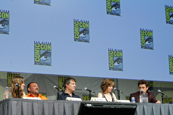 Comic-Con 2009 - Day 2 [event,technology,news conference,stage equipment,table,world,robert downey jr.,lionel wigram,rachel mcadams,actors,susan downey,joel silver,l-r,san diego convention center,comic-con,panel discussion]