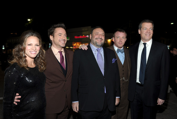 """Premiere Of Warner Bros. Pictures' """"Sherlock Holmes: A Game Of Shadows"""" - Red Carpet [sherlock holmes: a game of shadows,suit,event,formal wear,tuxedo,night,smile,robert downey jr.,susan downey,joel silver,guy ritchie,lionel wigram,l-r,warner bros. pictures,red carpet,premiere]"""