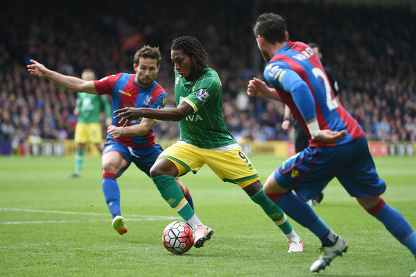 Crystal Palace v Norwich City - Premier League [player,sports,soccer player,sports equipment,football player,soccer,team sport,ball game,football,sport venue,dieumerci mbokani,r,joel ward,v,c,ball,crystal palace,norwich city,premier league,l]