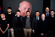 (L-R) Jordi Alba, Gerard Pique, Assistant Coach Juan Carlos Unzue, Head coach Luis Enrique Martinez, President Josep Maria Bartomeu, Andres Iniesta, member of the Board of Directors Jordi Moix and Sergio Busquets of FC Barcelona pay tribute to late Dutch football star Johan Cruyff in a special condolence area set up at Camp Nou stadium on March 29, 2016 in Barcelona, Spain.  Former player and coach of FC Barcelona Johan Cruyff died on March 24, 2016 at the age of 68 after losing a battle with lung cancer.