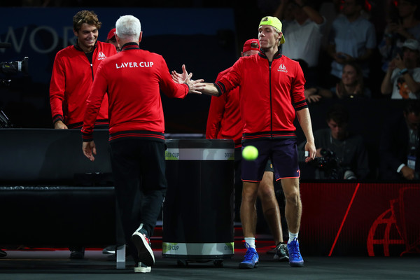 Laver Cup 2019 - Day 2 [sports,racquet sport,ball game,sports equipment,tennis,championship,wall ball sports,tournament,individual sports,competition event,denis shapovalov,john mcenroe,captain of team world,players,john isner,team europe,palexpo,team world,laver cup,singles match]