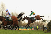 Tony McCoy jumps Becher's Brook as he rides Don't Push It (6) to victory during The John Smith's Grand National Steeple Chase at Aintree racecourse on April 10, 2010 in Liverpool, England.