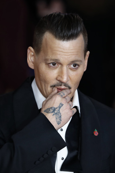 'Murder on the Orient Express' World Premiere - Red Carpet Arrivals [murder on the orient express,film,photo,chin,nose,forehead,eyebrow,suit,gentleman,hairstyle,moustache,cheek,tuxedo,red carpet arrivals,johnny depp,us,london,world premiere,world premiere,arrival,johnny depp,murder on the orient express,united states of america,film,actor,musician,photograph,film producer,fantastic beasts and where to find them]