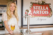 WIMBLEDON, ENGLAND - JULY 13 Clara Paget learns to pour the perfect Chalice of Stella Artois at the Wimbledon Championships on Ladies' Finals Day on July 13, 2019 in Wimbledon, England.