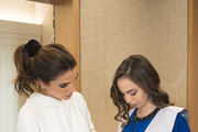 AMMAN, JORDAN- MAY 22: In this handout image provided by the Royal Hashemite Court,  Queen Rania of Jordan (R), during the graduation ceremony of Princess Salma (L) from the International Academy on May 22, 2018 at Amman, Jordan.