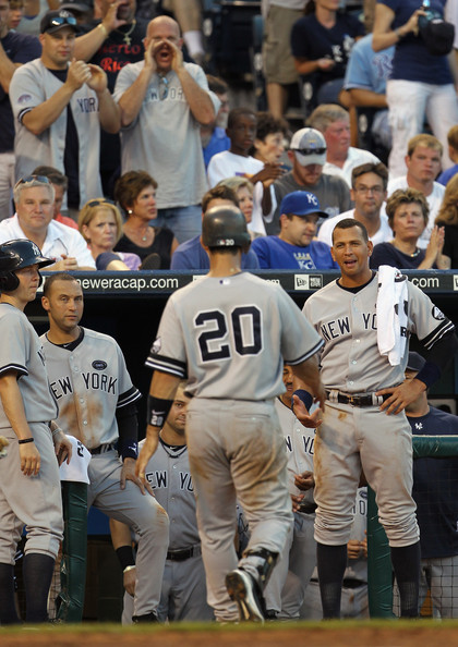 Jorge Posada Alex Rodriguez #13 of the New York Yankees waits to congratulate Jorge Posada #20 after Posada hit a home run during the 6th inning of the game against the Kansas City Royals on August 14, 2010 at Kauffman Stadium in Kansas City, Missouri.