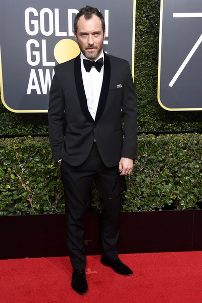75th Annual Golden Globe Awards - Arrivals [suit,red carpet,formal wear,carpet,tuxedo,clothing,premiere,outerwear,blazer,flooring,arrivals,jude law,the beverly hilton hotel,beverly hills,california,golden globe awards,the 75th annual golden globe awards]