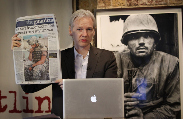 Julian Assange Julian Assange of the WikiLeaks website holds up a copy of The Guardian newspaper as he speaks to reporters in front of a Don McCullin Vietnam war photograph at The Front Line Club on July 26, 2010 in London, England. The WikiLeaks website has published 90,000 secret US Military records. The Guardian and The New York Times newspapers and the German Magazine Der Spiegel have also published details today.