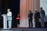 Julie Andrews speaks as she is awarded the Golden Lion for Lifetime Achievement from the President of the Venice Biennale Paolo Baratta, Venice Film Festival director Alberto Barbera and Luca Guadagnino during the 76th Venice Film Festival at Sala Grande on September 02, 2019 in Venice, Italy.