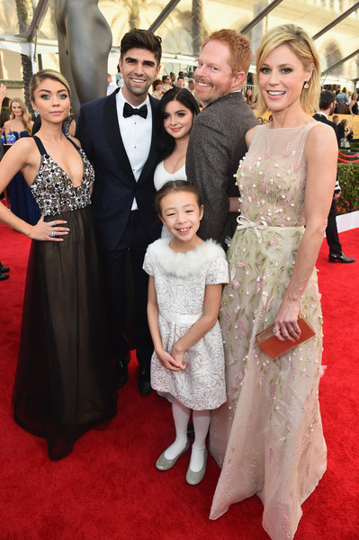 21st Annual Screen Actors Guild Awards - Red Carpet [red carpet,carpet,flooring,event,premiere,dress,gown,fashion,formal wear,suit,screen actors guild awards,l-r,red carpet,sarah hyland,justin mikita,actors,ariel winter,jesse tyler ferguson,julie bowen,aubrey anderson-emmons]